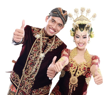 happy traditional java wedding couple husband and wife showing thumbs up photo