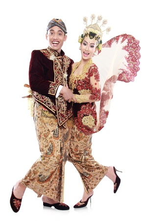 portrait of happy traditional java wedding couple husband and wife isolated over white background photo