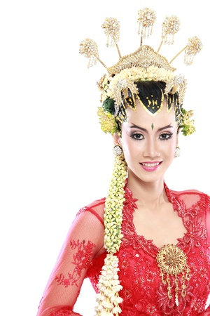 indonesia culture: woman traditional wedding dress of java. isolated over white background Stock Photo