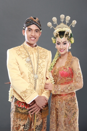 traditional java wedding couple husband and wife hold each other photo