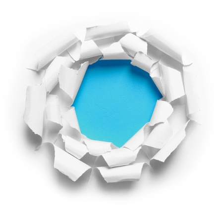 Hole ripped in three white paper on blue background photo