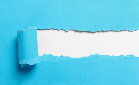 paper hole: ripped blue paper over white background Stock Photo