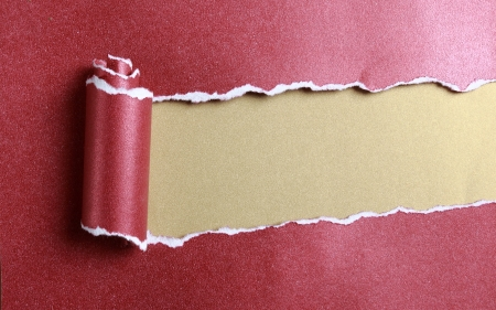 ripped red paper over gold color background Stock Photo - 20166835