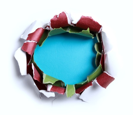 blank center: Hole ripped in white paper with red and green paper on blue background