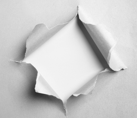 gray torn paper with square shape over white background photo