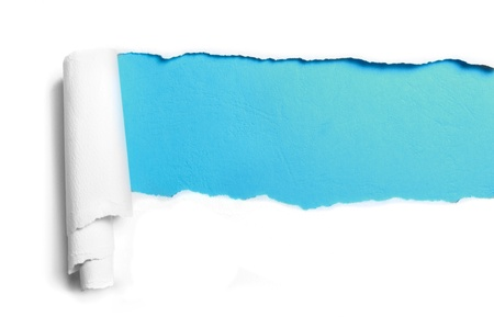 torned: ripped white paper over blue color background