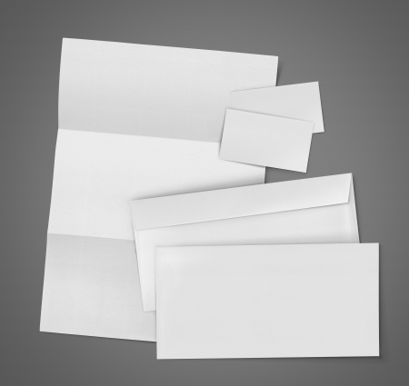 letter head: business stationary set. envelope, sheet of paper and business card on gray background