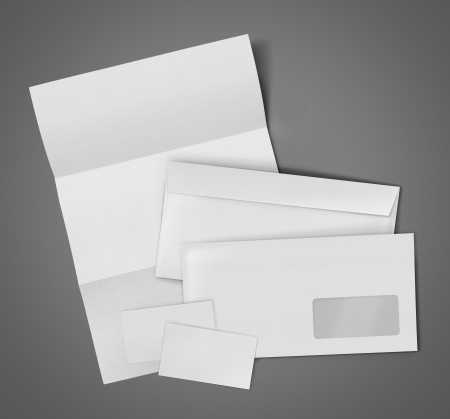 stationary set: business stationary set. envelope, sheet of paper and business card on gray background