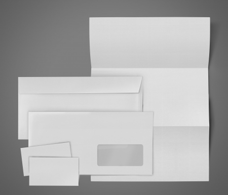 business stationary set. envelope, sheet of paper and business card on gray background photo
