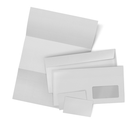 business stationary set. envelope, sheet of paper and business card on white background photo