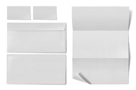 marca libros: sistema inm?vil negocios. sobre, hoja de papel y tarjeta de visita en el fondo blanco