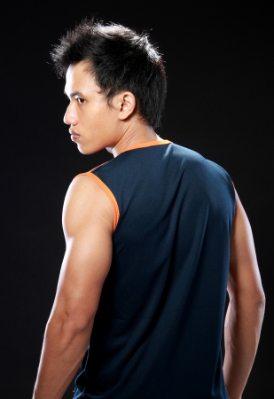 muscled: Young male model looking to the side shot from behind Stock Photo