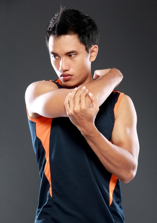 young fitness man making stretching exercises photo