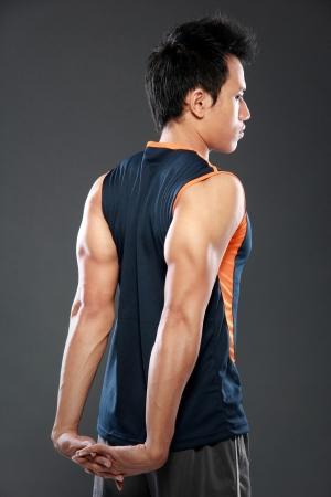 young athlete man making stretching exercises photo