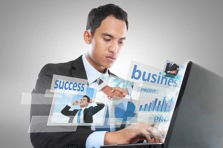 conceptual image of business man working with laptop photo