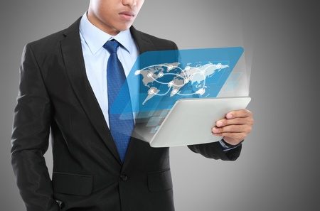 Business man using tablet PC. conceptual image of social connection Stock Photo - 20599508