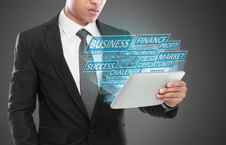 Business man using tablet PC. conceptual images of building success business photo