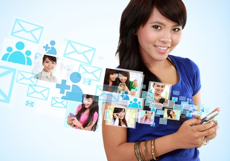 Portrait woman using mobile phone, text messaging, social media, on mobile phone photo