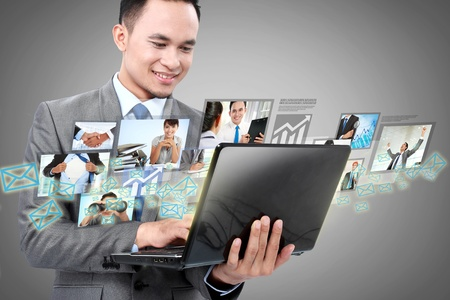 Portrait of businessman using laptop and communicating with his team across the world. International communications concept photo