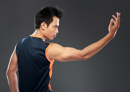 muscled: Side view of a young man exercising yoga Stock Photo
