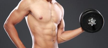 barbel: Powerful muscular man lifting weights Stock Photo