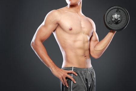 barbel: Powerful muscular man lifting weights Stock Photo