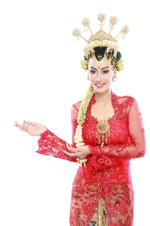 asian wife: Happy of woman wearing traditional of java presenting blank area isolated over white background