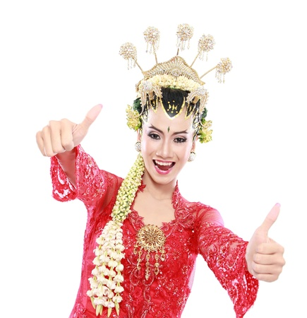 Happy of woman traditional java showing thumbs up isolated on white background