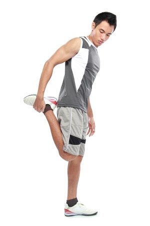 flexed: Young athlete attractive doing fitness exercises, flexed leg Stock Photo