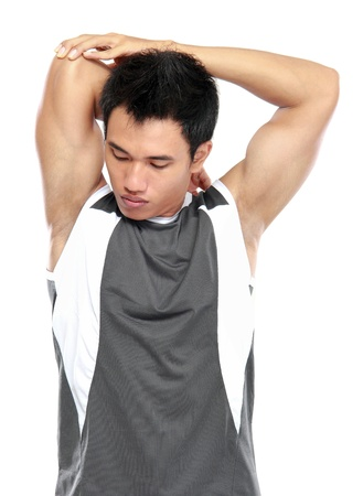 portrait of young athlete man making stretching exercises photo