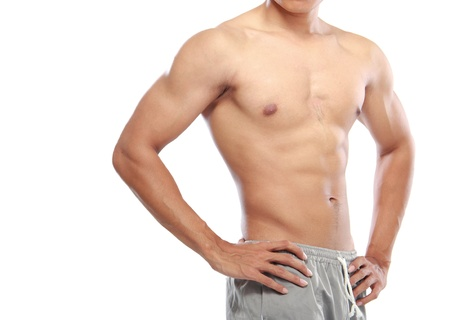male chest: a very fit young male flexing his muscles