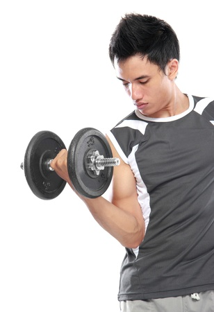 asian abs: portrait of Young man is exercising with barbell in gym to strengthen the muscles