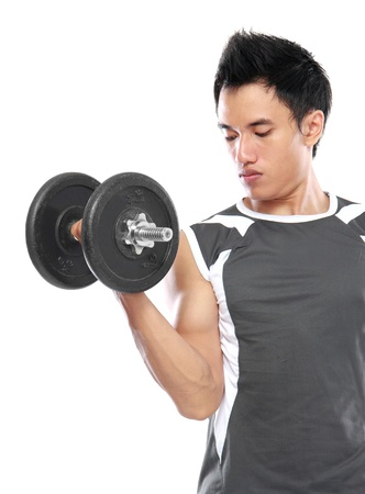 portrait of Young man is exercising with barbell in gym to strengthen the muscles photo