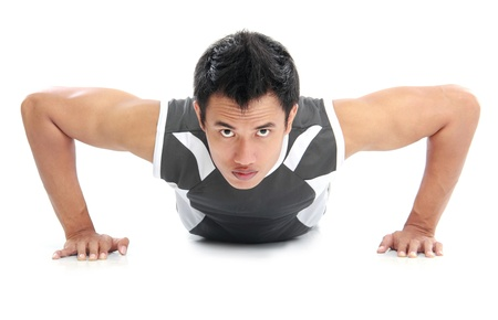 muscled: a close up of a man doing push ups with an intense expression on his face Stock Photo