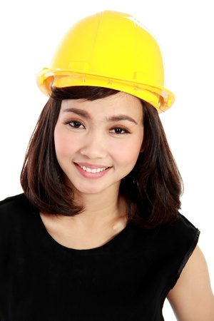Cheerful female construction engineer isolated on white background Stock Photo - 20599571