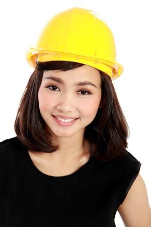 Cheerful female construction engineer isolated on white background Stock Photo - 20599571