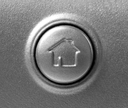 close up of button with home symbol on the keyboard photo
