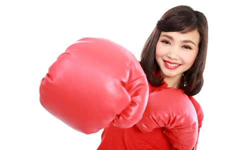 woman smiling happy wearing red boxing gloves isolated on white background photo