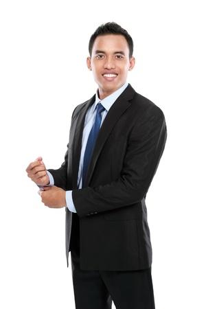 幸せな笑みを浮かべて青年実業家の白い背景で隔離のフルボディの肖像画 写真素材