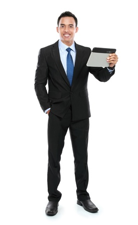 Business man holding a tablet PC isolated on white background photo