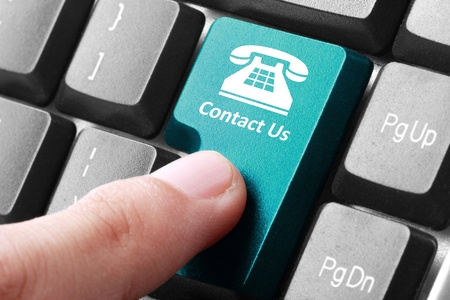 enquiry: Closeup of contact us button on the keyboard Stock Photo