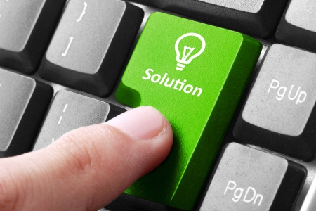design solutions: Closeup of green solution button on the keyboard