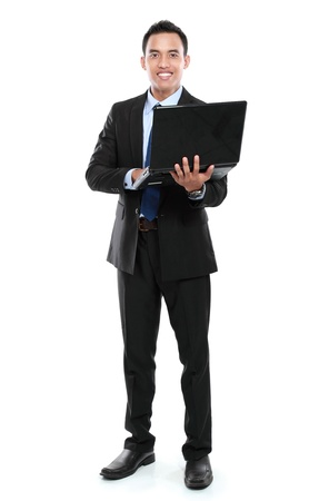 it is isolated: Business man with laptop looking at camera isolated on white background