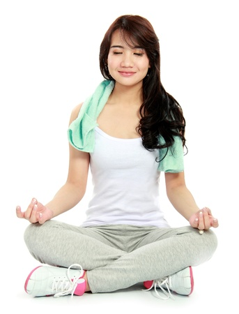 portrait sport woman sitting and doing yoga exercise photo