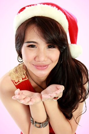 Beauty asian young girl  smiling and wear a hat santa and raised hands photo