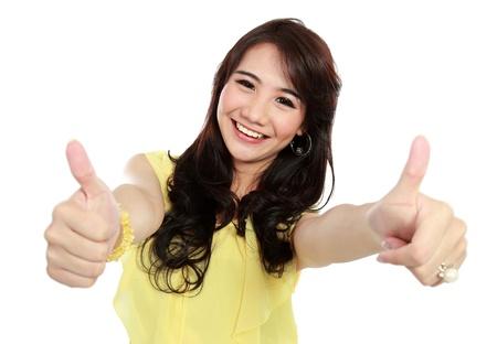 happy teenager girl give you two tumb up photo