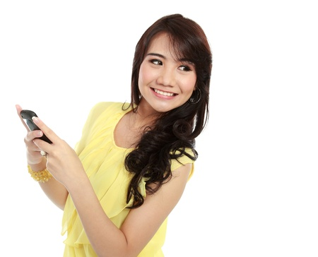 busy teenager girl hold the handphone and look the other way photo