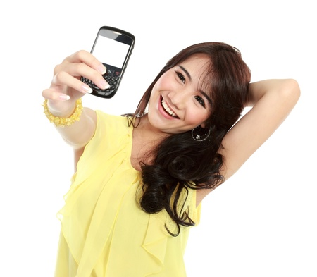 self expression: smiling teenager girl take the picture her self with handphone