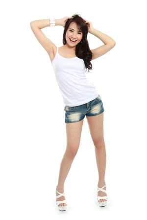 sexy asian girl: Portrait of a happy young girl in action and looking at camera