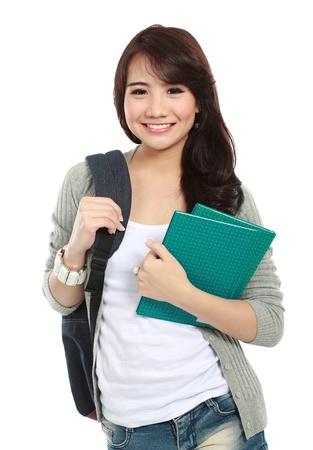 キャンパスに行く準備ができて幸せな学生の肖像画